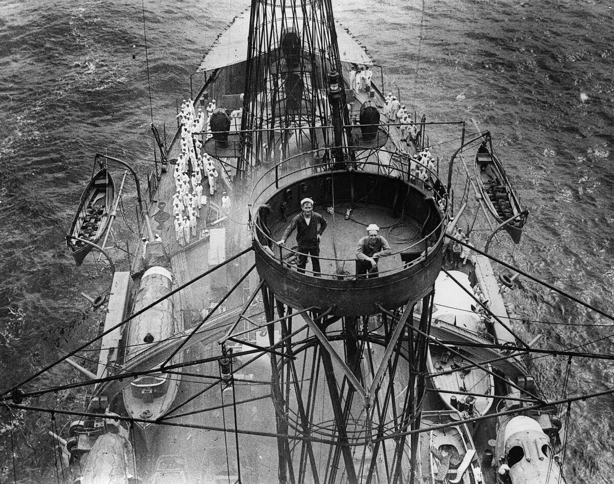 Two sailors in the crow's nest on board the American ship the Kearsarge-class pre-dreadnought battleship USS Kentucky, 1917.