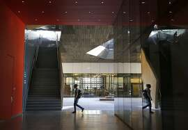 A student walks towards a staircase in the courtyard of the McMurtry Building for the Department of Art and Art History in Stanford, Calif. on Tuesday, Oct. 13, 2015.