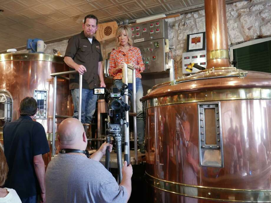 "Tanji Patton, former WOAI-TV anchorwoman, shoots a TV segment with brewmaster Rick Green at Fredericksburg Bed & Brew. Starting next spring, her own food and wine show, ""Goodtaste with Tanji"" will be seen across Texas. Photo: Photos Courtesy Tanji Patton"