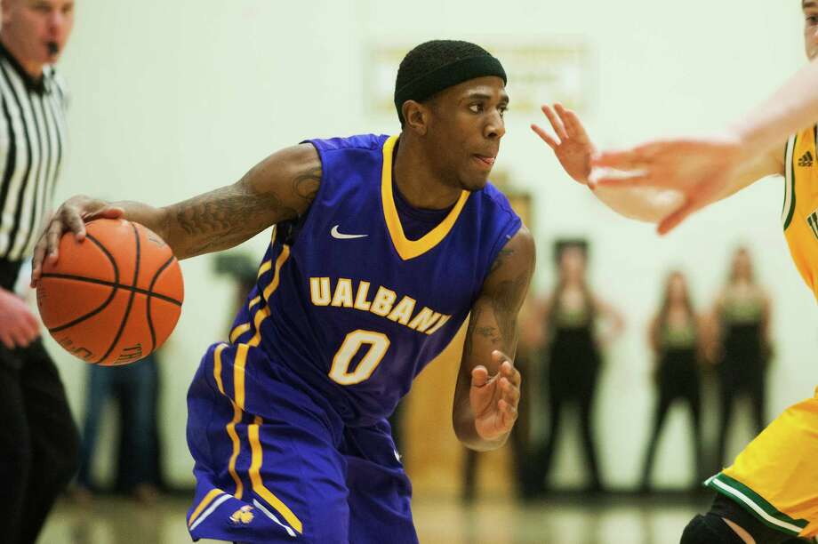 UAlbany guard Evan Singletary drives to the basket during a men's basketball game between the  Great Danes and Vermont at Patrick Gym on Wednesday, Jan. 28, 2015, in Burlington, Vt. (Brian Jenkins / Special to the Times Union)