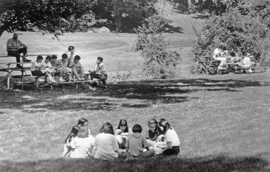 The Greenwich Japanese School, also known as the Japanese School of New York, opened its doors for its inaugural school year in Sept. 1992 after relocating from Yonkers, N.Y. Here, students take their lunch break in the field. Photo: Mel Greer / Mel Greer / Greenwich Time
