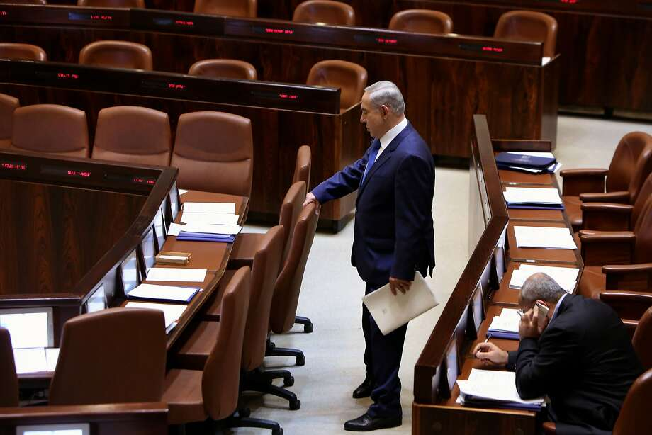 """Israeli Prime Minister Benjamin Netanyahu walks to his seat before delivering a speech at the Knesset (Israeli parliament) on October 12, 2015, in Jerusalem. Netanyahu said that """"knife terror will not defeat us"""" as he addressed parliament amid Palestinian unrest and a wave of stabbing attacks targeting Jews. AFP PHOTO / GALI TIBBONGALI TIBBON/AFP/Getty Images Photo: Gali Tibbon, AFP / Getty Images"""