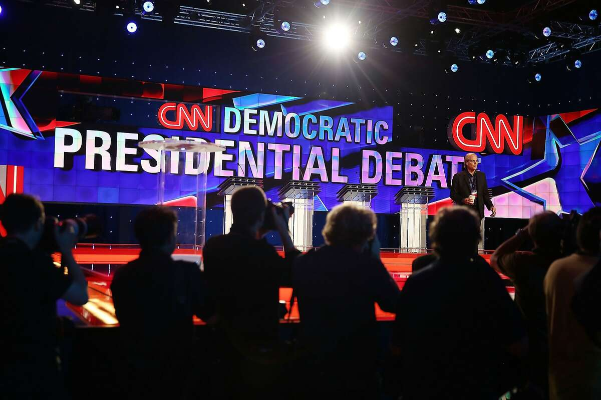 Journalists check the debate stage during a walk-through before the Democratic Presidential candidates arrive for their CNN Facebook Democratic Debate this evening at the Wynn Las Vegas on October 13, 2015 in Las Vegas, Nevada. Democratic presidential candidates are participating in the party's first presidential debate.