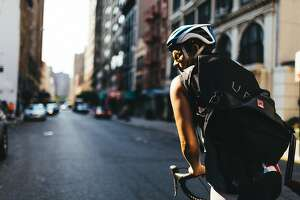 UberRush, the ride-hailing company's foray into on-demand deliveries, includes bike messenger as well as drivers. Debuting Wednesday in San Francisco and Chicago, it is already available in New York, as shown here.