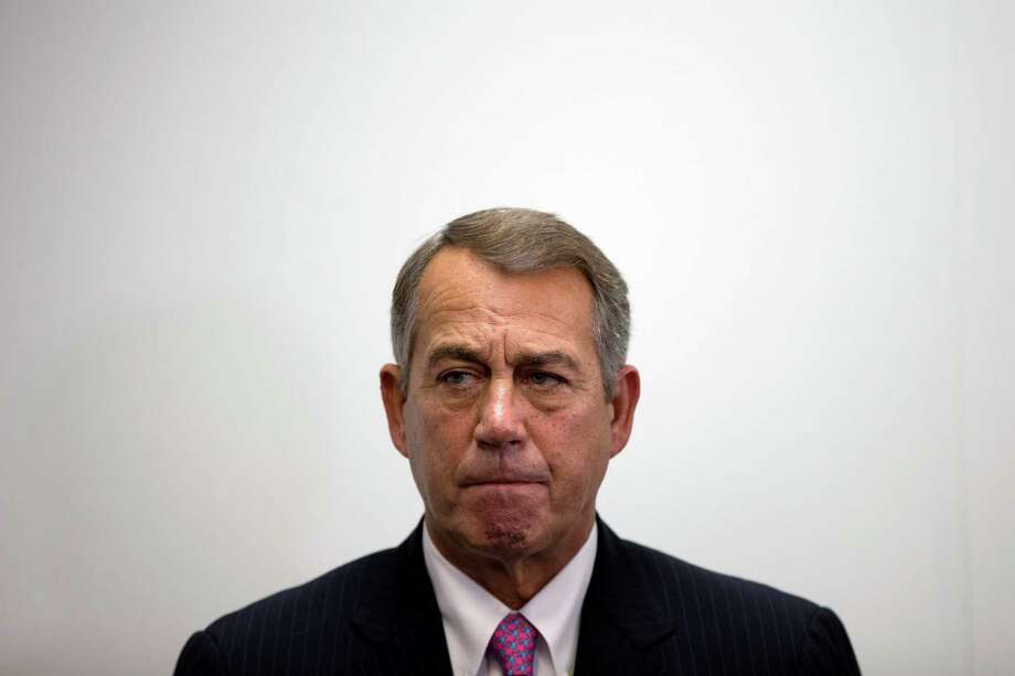 "FILE - In this Oct. 7, 2015, file photo, outgoing House Speaker John Boehner of Ohio listens as House Majority Leader Kevin McCarthy of California, speaks during a news conference on Capitol Hill in Washington. Speaking on ""Fox News Sunday,"" on Sunday, Oct. 11, 2015, Freedom Caucus Chairman Jim Jordan of Ohio said his group would ""look favorably"" on U.S. Rep. Paul Ryan if he runs for speaker, but for now the group is sticking with its endorsement of Florida's Rep. Daniel Webster. (AP Photo/Evan Vucci, File) Photo: Evan Vucci, STF / Associated Press / AP"