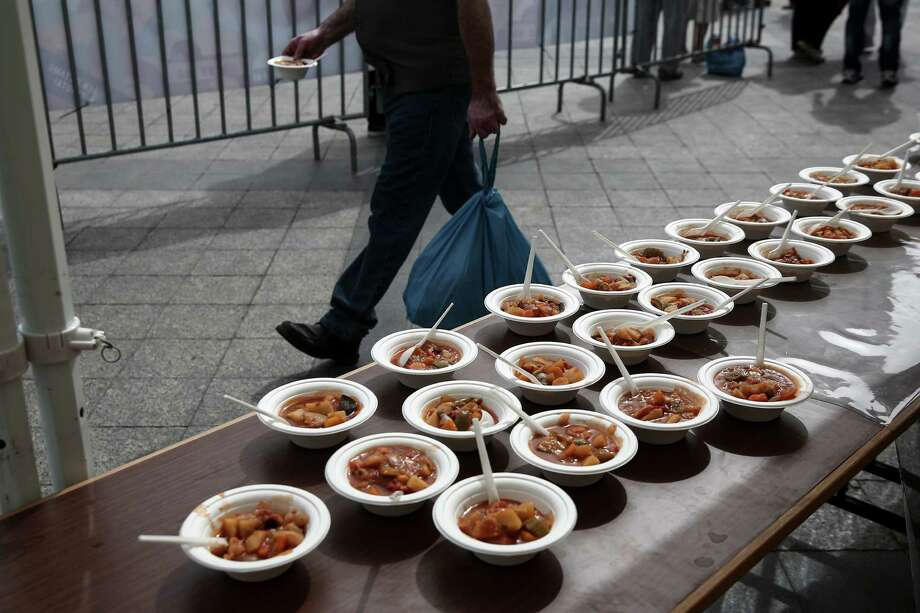 There are innovative ways to stem food waste. A man walks past served meals made with 'wasted' produce deemed unsuitable by food stores because of their appearance, during an event against food waste, in Athens, Greece Oct. 11. Photo: Yorgos Karahalis /Associated Press / AP