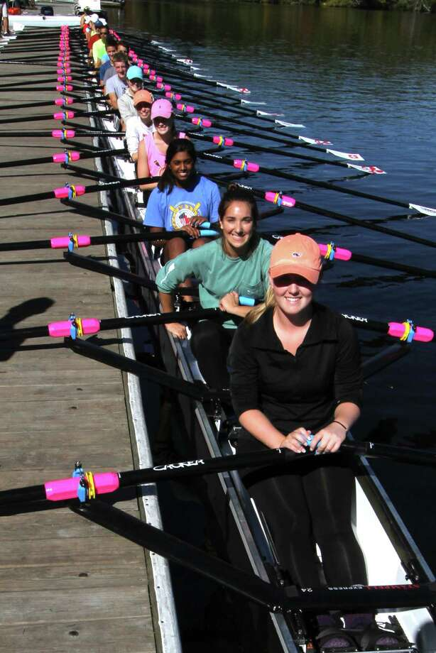 Shaker Crew, the rowing team of Shaker High School in Latham, New York, is sending an unprecedented 4 boats to the Head of the Charles Regatta in Boston on Sunday, October 18.  After training on the Charles River on Monday, October 12, Shaker rowers were able to check out the world's longest racing boat:  a 24-seat sculling shell, made by Staempfli Boats of Switzerland, currently on tour in the United States.  (www.row24tour.com) From bottom (stern) towards top (bow):  Samantha Mysliwiec, Grace Conroy, Niki Kura, Lauren Murawski, Cierra Orlyk, Caroline Pustay, Logan Finning, Jeffrey Endler and Ben Beretvas. (Lise Hafner) Photo: Lise M Hafner / ©Lise M. Hafner