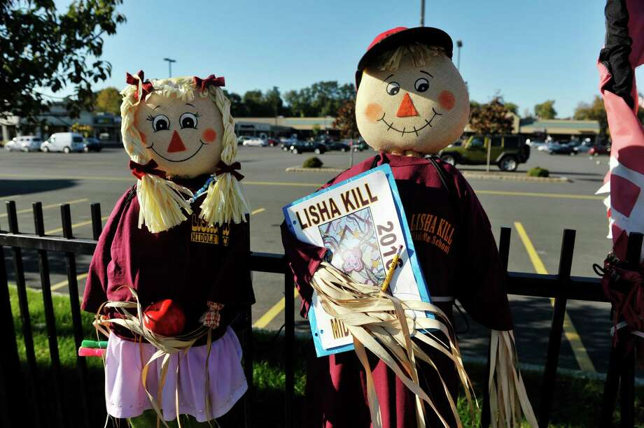 A view of scarecrows made by Lisha Kill Middle School on display along Central Ave. as part of the Scarecrows on the Avenue contest, put on by the Central Business Improvement District, seen here on Monday, Oct. 12, 2015, in Albany, N.Y.   (Paul Buckowski / Times Union) Photo: PAUL BUCKOWSKI / 10033702A