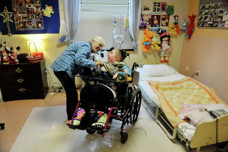 Karen Kister visits with Katie at St. Margaret's Center on Tuesday, Oct. 13, 2015, in Albany, N.Y.  Kister recently retired after 50 years as a caregiver to profoundly disabled children at the center.  Kister started working here as a teenager.  (Paul Buckowski / Times Union) Photo: PAUL BUCKOWSKI / 10033734A