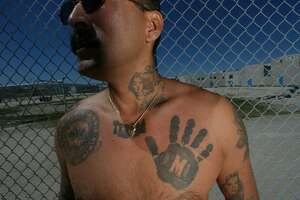 Photos: Tattoos define gangs around the world - Photo