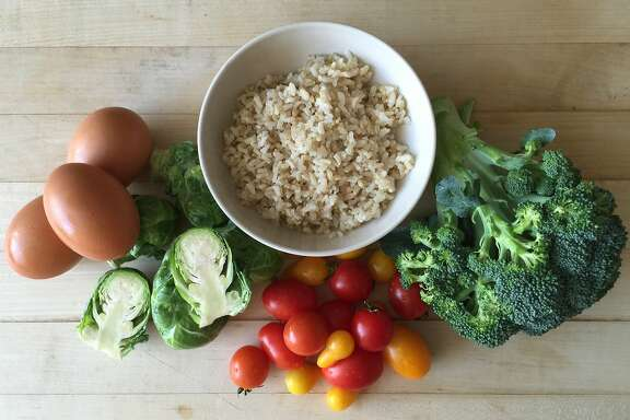 Rice Bowl With Roasted Brussels Sprouts, Broccoli, Tomatoes & Egg