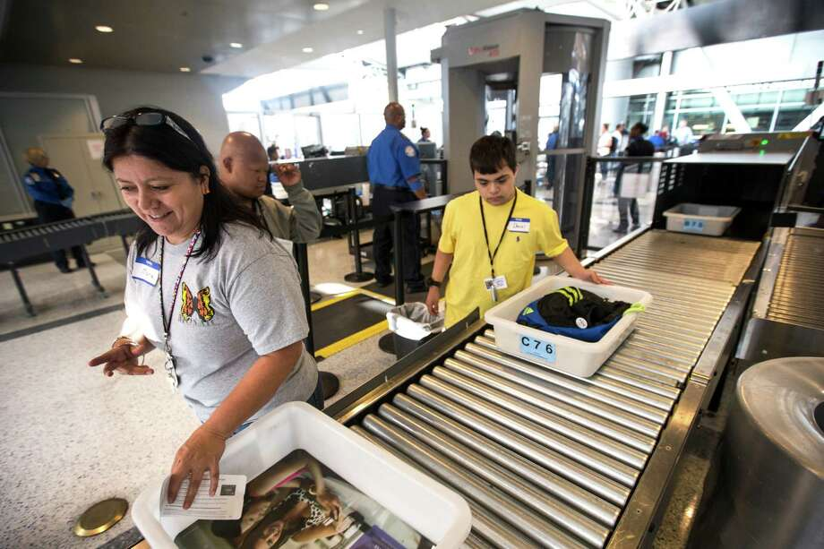 Maria Rodriguez, left, and Daniel Lozano go through security as part of a Wings for All event at George Bush Intercontinental Airport on Tuesday, Oct. 13, 2015, in Houston.  Photo: Brett Coomer, Staff / © 2015 Houston Chronicle