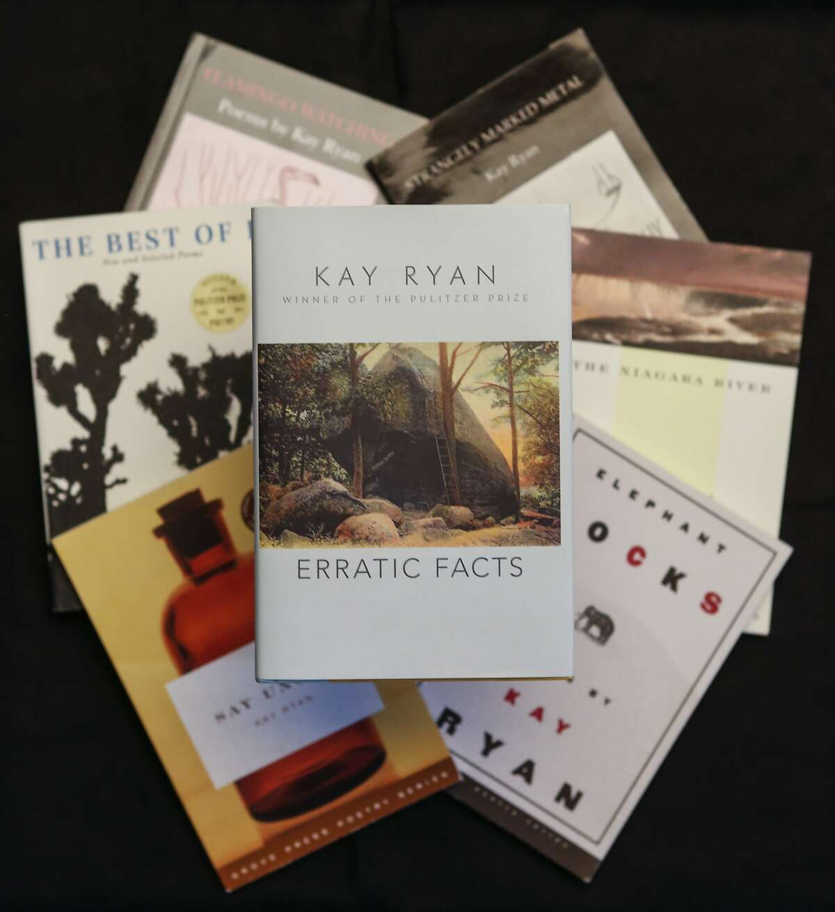 """Books by Kay Ryan including her newest title, """"Erratic Facts,"""" are seen on Tuesday, Oct. 13, 2015 in San Francisco, Calif."""