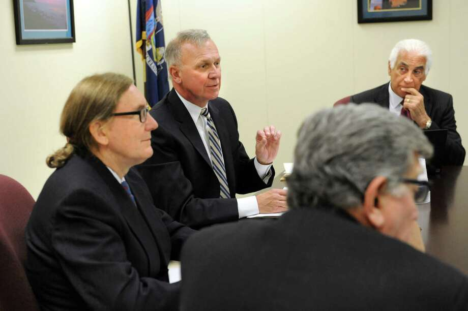 Co-chair Peter Kosinsky, representing Republicans, center, speaks during the State Board of Elections meeting on Tuesday, Oct. 13, 2015, at the New York Board of Elections in Albany, N.Y. At left is co-chair Douglas Kellner, representing Democrats. (Cindy Schultz / Times Union) Photo: Cindy Schultz / 10033727A