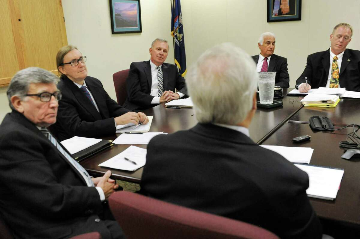 Co-chair Peter Kosinsky, representing Republicans, center, and co-chair Douglas Kellner, representing Democrats, second from left, listen to other members during the State Board of Elections meeting on Tuesday, Oct. 13, 2015, at the New York Board of Elections in Albany, N.Y. At left is (Cindy Schultz / Times Union)