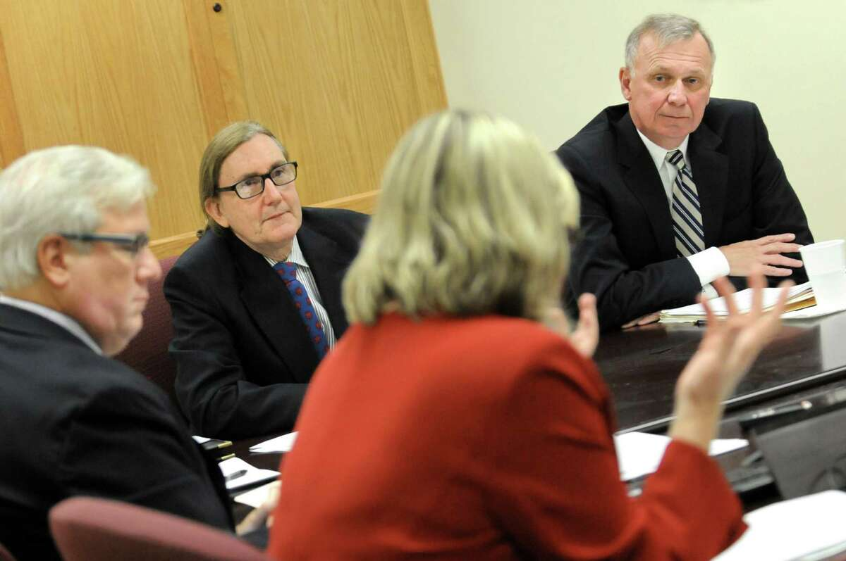 Co-chair Peter Kosinsky, representing Republicans, right, and co-chair Douglas Kellner, representing Democrats, second from left, listen to other members during the State Board of Elections meeting on Tuesday, Oct. 13, 2015, at the New York Board of Elections in Albany, N.Y. At left is (Cindy Schultz / Times Union)