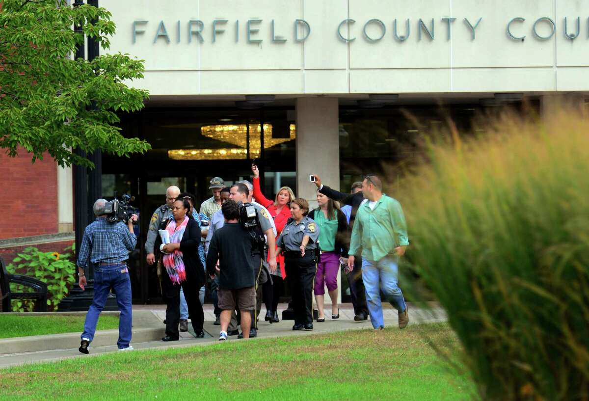 The media surround a juror after the court case involving an eight year old defendant outside of the Fairfield County Courthouse in downtown Bridgeport, Conn. on Tuesday October 13, 2015. The boy was being sued by Jennifer Connell who was injured by him four years ago.