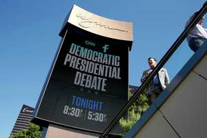 The Latest: Biden to watch debate from home as he weighs run - Photo