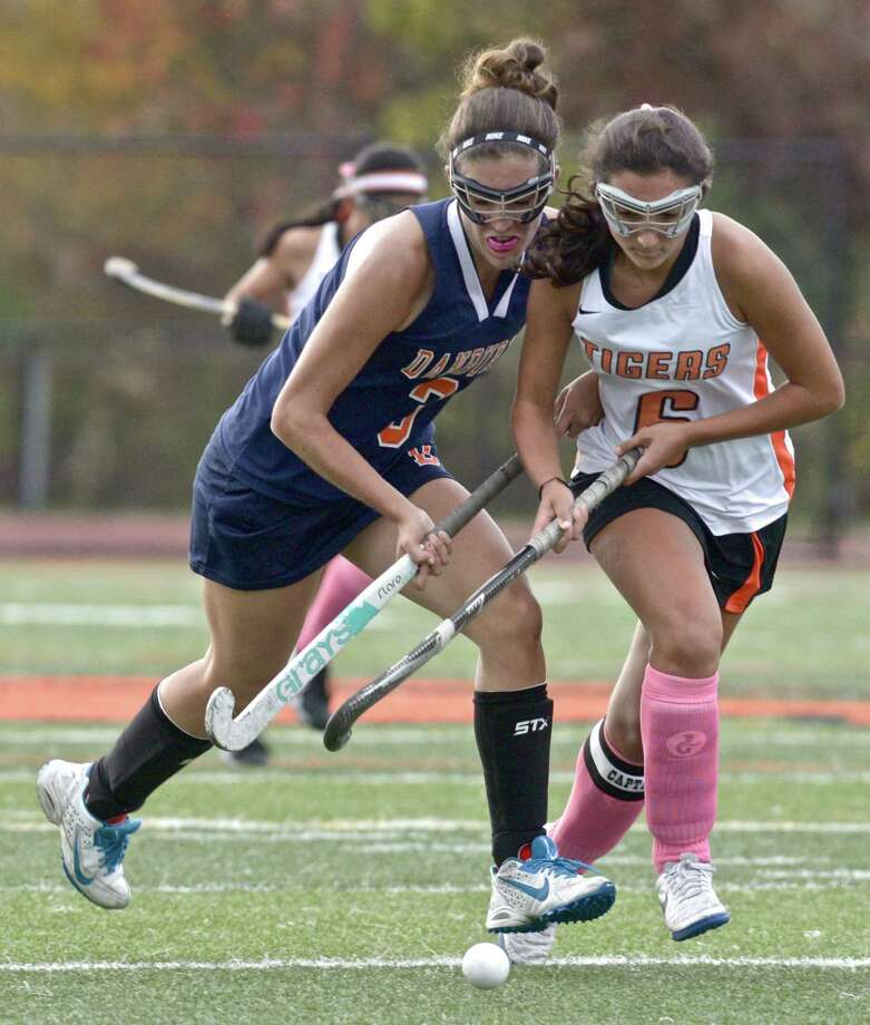 Danbury's Danielle Reisert (3) and Ridgefield's Sarah Wilson (6) fight for the ball in the girls high school field hockey game between Danbury and Ridgefield high schools, on Tuesday afternoon, October 13, 2015, at Ridgefield High School, Ridgefield, Conn. Photo: H John Voorhees III / Hearst Connecticut Media / The News-Times
