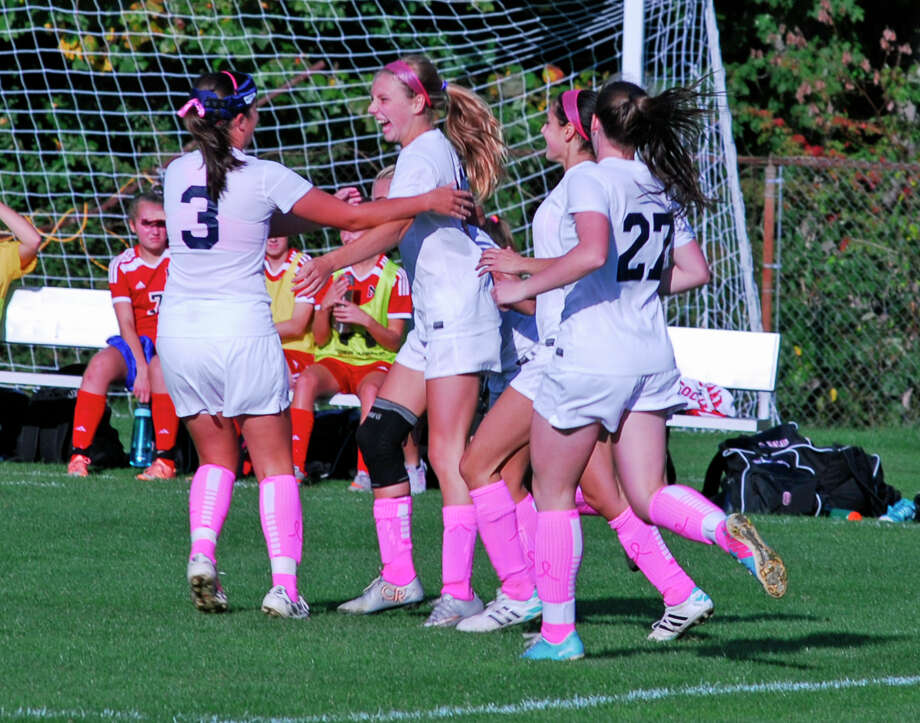 Staples players celebrate scoring a goal against New Canaan on Tuesday, October 13, 2015 in Westport Connecticut. The Wreckers won 4-1. Photo: Ryan Lacey/Staff Photo / Westport News Contributed
