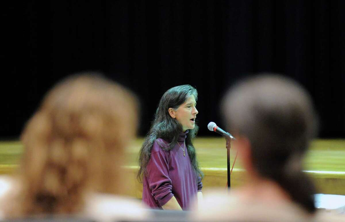 Gaetane Francis, a parent of Greenwich public school students, speaks during the Greenwich school district forum to discuss the possibility of new start times for the Greenwich public schools next year, held at Western Middle School in Greenwich on Tuesday.