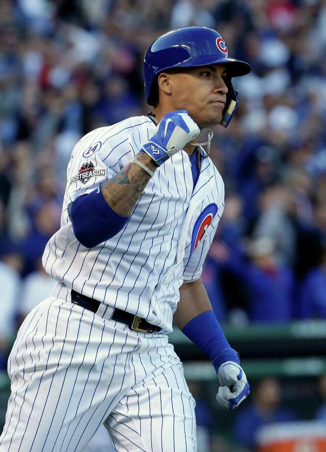 Chicago Cubs' Javier Baez (9) pumps his fist as he runs bases after hitting a three run home run against the St. Louis Cardinals National League Division Series, Tuesday, Oct. 13, 2015, in Chicago. (AP Photo/Nam Y. Huh) ORG XMIT: CXC129 Photo: Nam Y. Huh / AP