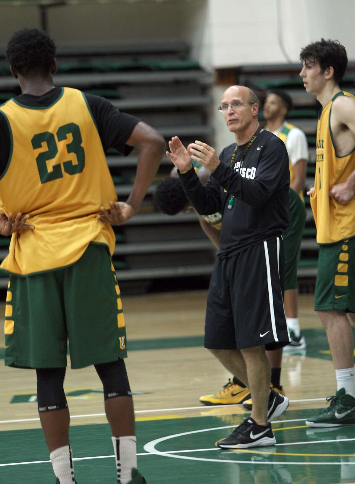 Associate Coach Frank Allocco discuss plays with the team during practice at the USF Memorial Gym October 13, 2015.