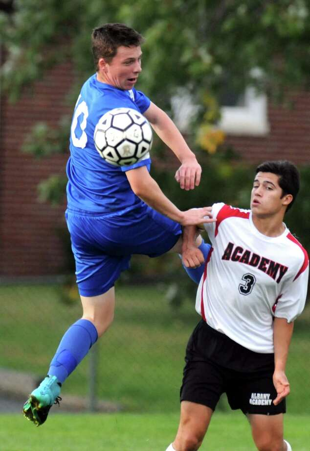 LaSalles David Hamlin and Academy's Michael DeVito battle for the ball during their boy's high school soccer game on Tuesday Oct. 13, 2015 in Albany, N.Y. (Michael P. Farrell/Times Union) Photo: Michael P. Farrell / 10033715A