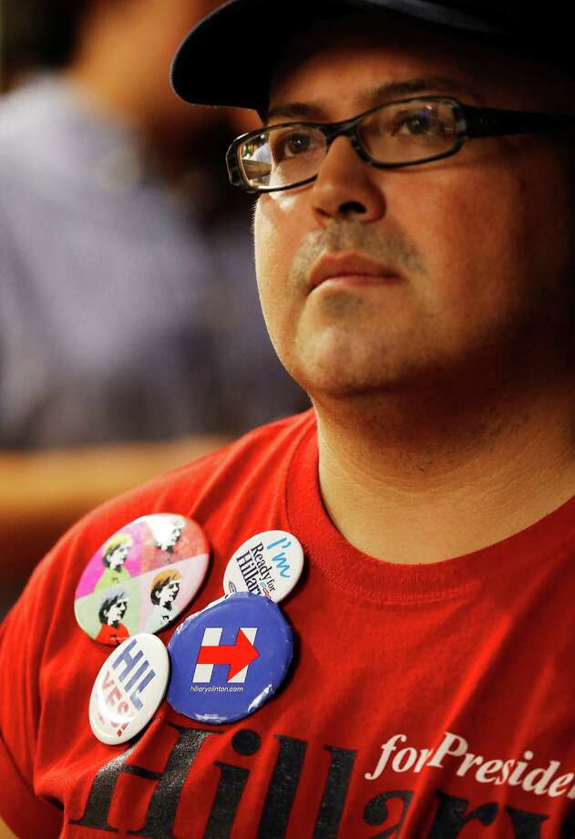 San Antonio voter Anthony Morales wears a series of buttons to show his support for Hillary Clinton while attending a viewing party for the first Democratic Party Presidential debate held at Alamo Beer Hall on Tuesday, Oct. 13, 2015. Democratic party icon Leticia Van de Putte joined by several other local Democratic politicians rallied their constituents for a debate between Democratic presidential hopefuls Hillary Clinton, U.S. Senator Bernie Sanders, former Virginia Senator Jim Webb, former Rhode Island Gov. Lincoln Chafee and former Maryland Gov. Martin O'Malley. Photo: Kin Man Hui, San Antonio Express-News / ©2015 San Antonio Express-News