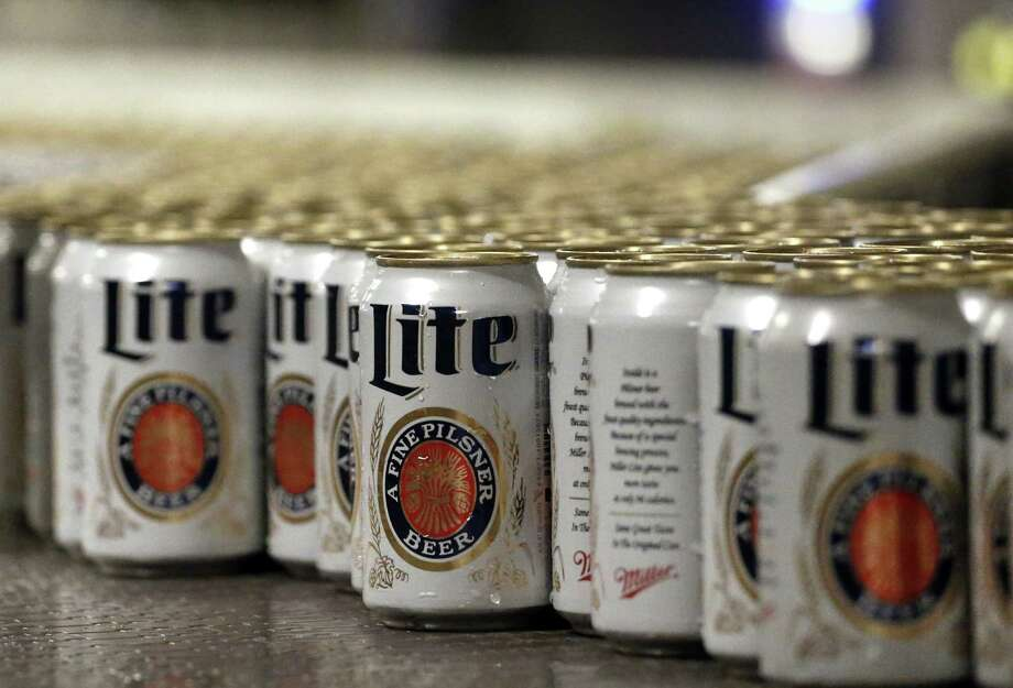 Miller Lite was the top beer choice for people attending University of Texas football games in Austin this fall. (AP Photo/Brennan Linsley) Photo: Brennan Linsley, STF / AP