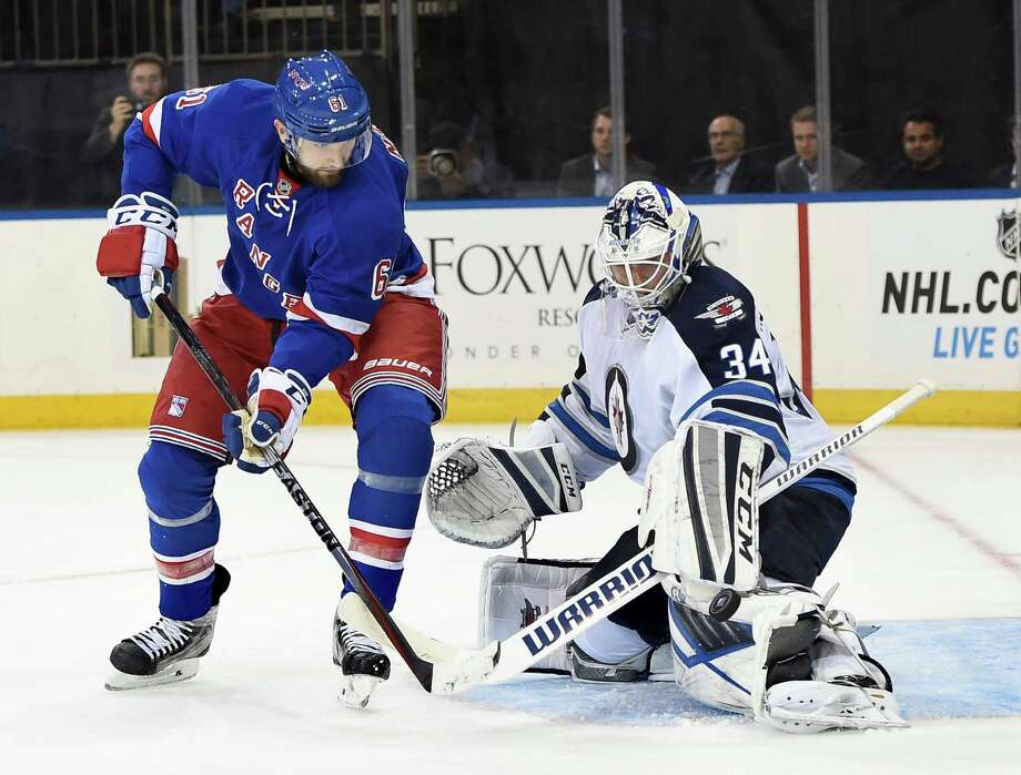 Winnipeg Jets goalie Michael Hutchinson (34) blocks a shot on goal by New York Rangers left wing Rick Nash (61) during the second period of an NHL hockey game on Tuesday, Oct. 13, 2015, in New York. (AP Photo/Kathy Kmonicek)  ORG XMIT: MSG106 Photo: Kathy Kmonicek / FR170189 AP