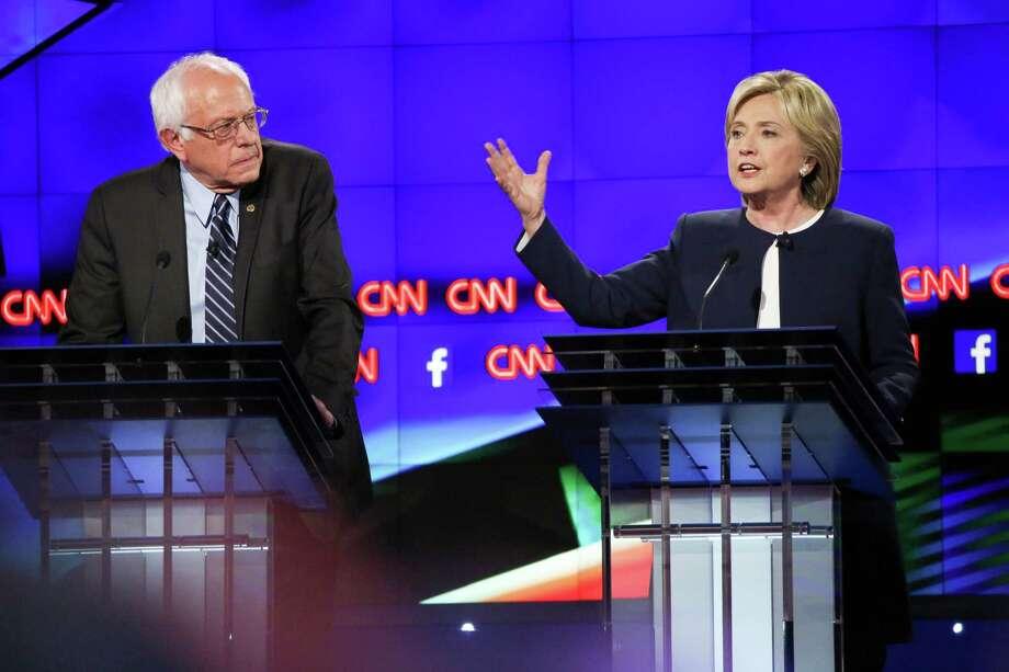 Democratic presidential hopefuls Bernie Sanders and Hillary Rodham Clinton during the Democratic presidential debate hosted by CNN in Las Vegas, Oct. 13, 2015. (Josh Haner/The New York Times) ORG XMIT: XNYT139 Photo: JOSH HANER / NYTNS