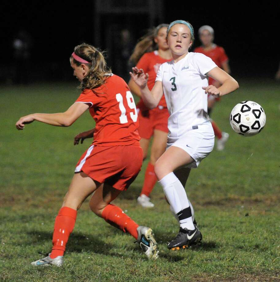 Niskayuna's Erica Wasserbach and Shen's Kendra Harbinger try to get control of the ball during their girls's high school soccer game on Tuesday Oct. 13, 2015 in Clifton, N.Y. (Michael P. Farrell/Times Union) Photo: Michael P. Farrell / 10033713A