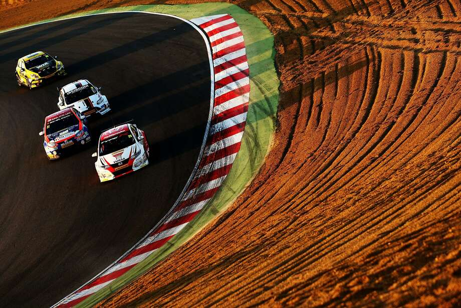 Matt Neal of Honda Racing heads a pack of cars down Paddock Hill during Race Three of the Final Round of the Dunlop MSA British Touring Car Championship at Brands Hatch on October 11, 2015 in Longfield, England. Photo: Ker Robertson