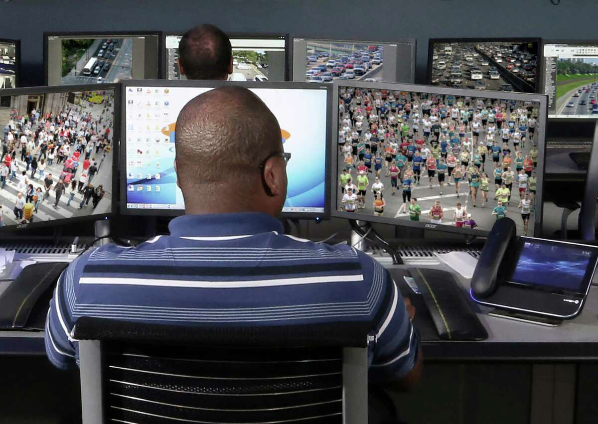 An A+ Technology & Security employee monitors a security feed from its Long Island Fusion Center located in Bay Shore, N.Y., similar to the new facility being built in Bridgeport.
