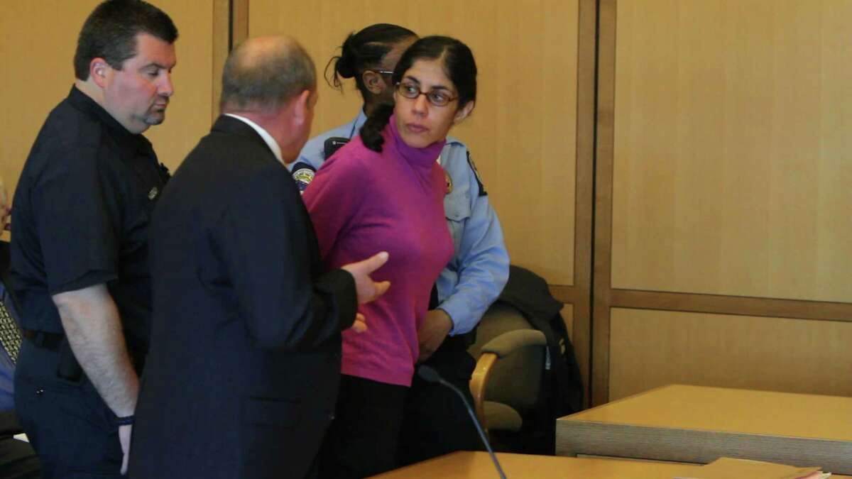 Sheila Davalloo looks back at the courtroom following her sentencing for the murder of Anna Lisa Raymundo by Judge Richard Comerford at state Superior Court in April 2012. At left is public defender Barry Butler. Davalloo's appeal was heard in state Supreme Court Wednesday.