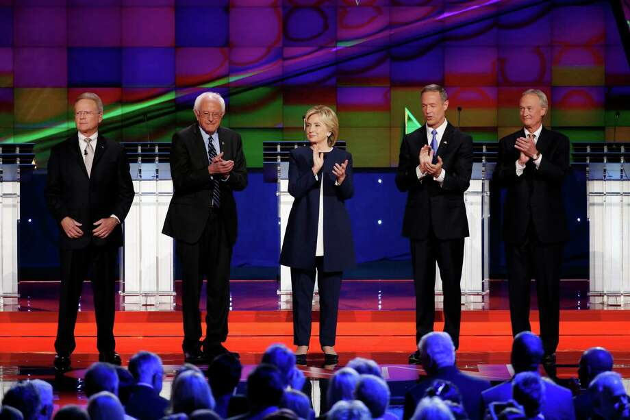 Democratic presidential candidates from left, former Virginia Sen. Jim Webb, Sen. Bernie Sanders, of Vermont, Hillary Rodham Clinton, former Maryland Gov. Martin O'Malley, and former Rhode Island Gov. Lincoln Chafee take the stage before the CNN Democratic presidential debate Tuesday. Photo: John Locher /Associated Press / AP