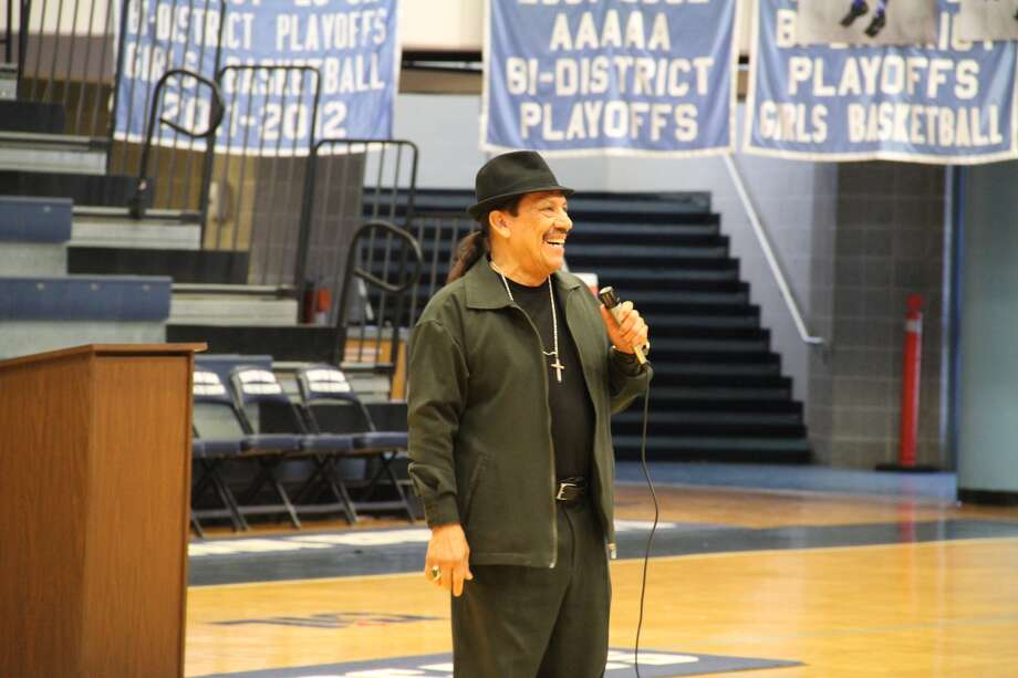 Sleepy eyes of students at South San Antonio High School were widened Tuesday morning when they filed into the campus' gym to find none other than the Machete, Danny Trejo, standing center court.