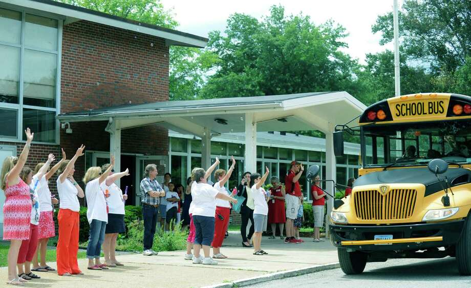 Teaachers and staff wave a goodbye to students on the final day of school at John Pettibone School in New Millford. June 17, 2015 Photo: Carol Kaliff / Carol Kaliff