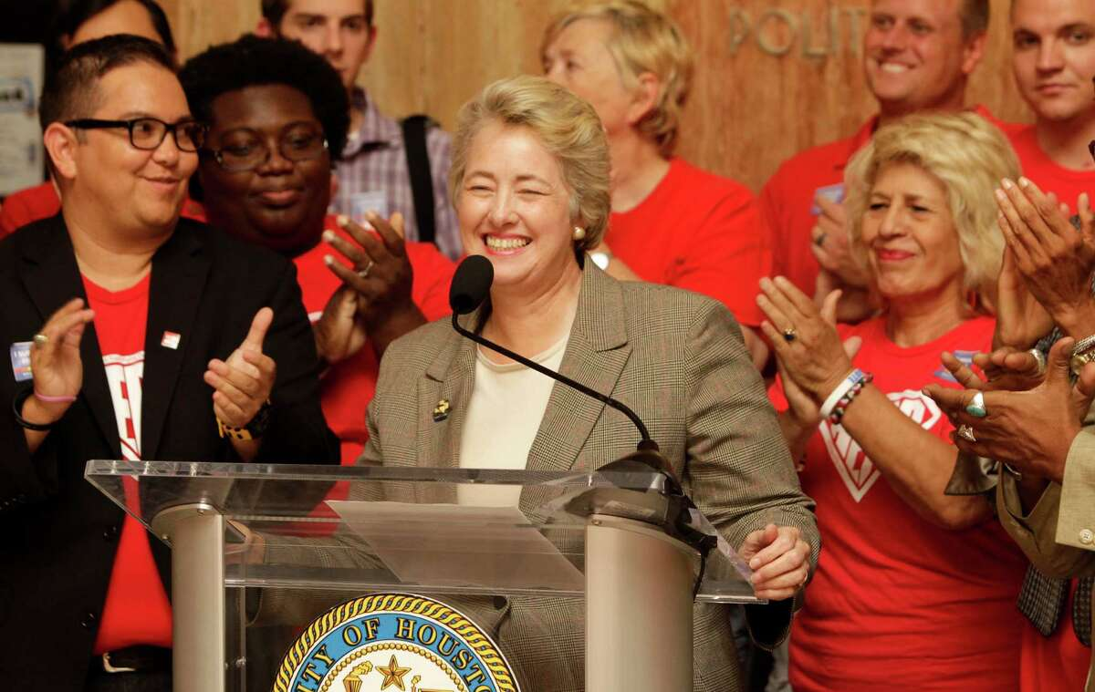 Houston Mayor Annise Parker is applauded by supporters during a media conference about the HERO issue in 2014.