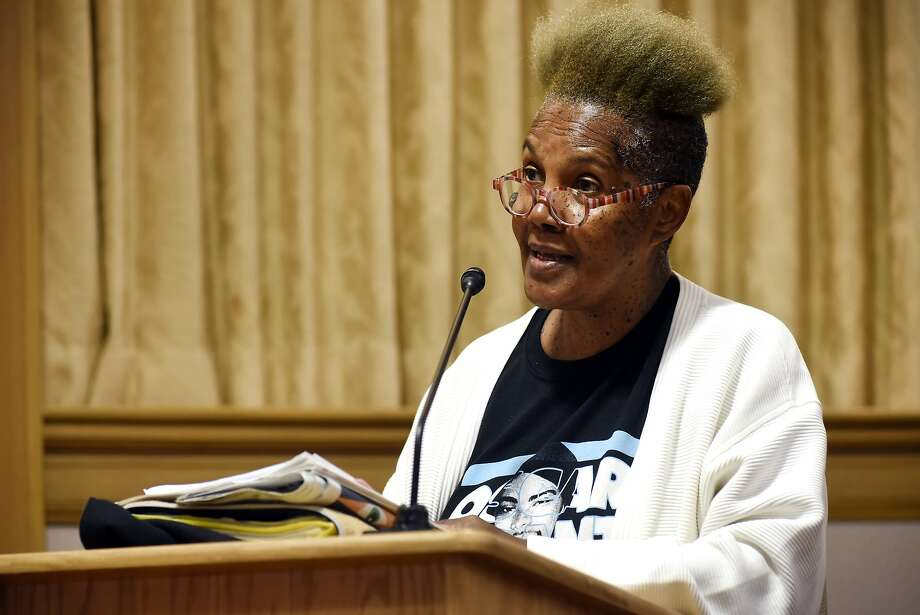 Asset Olugbala, of Oakland, speaks to council members during the public comment portion of an Oakland City Council public city committee meeting discussing African-American recruitment and retention in police force, at City Hall in Oakland on Friday, October 16, 2015. Photo: Michael Short, Special To The Chronicle