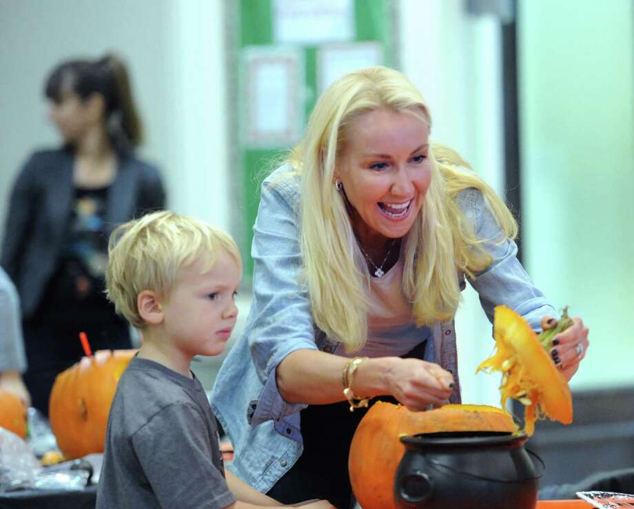 Greenwich resident, Chantal Erensen, right, and her son, Bode, 4, carve their pumpkin at last year's Halloween Happenings event at the Second Congregational Church in Greenwich, Conn., Saturday morning, Oct. 18, 2014. Photo: Bob Luckey / Bob Luckey / Greenwich Time