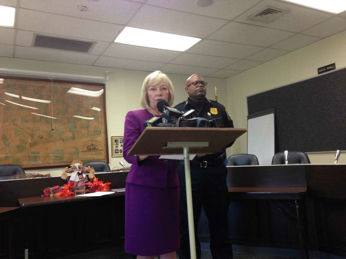 Supt. Janet Robinson, at the podium, and Police Chief Patrick Ridenhour speak to the media about a Stratford teacher accused of sexually assaulting a boy.