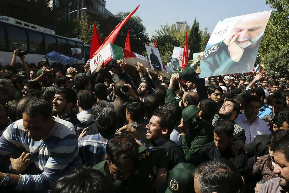 Mourners in Tehran carry the coffin of Revolutionary Guard Gen. Hossein Hamedani, who was killed by Islamic State militants near the Syrian city of Aleppo, according to state media. Photo: Vahid Salemi, Associated Press