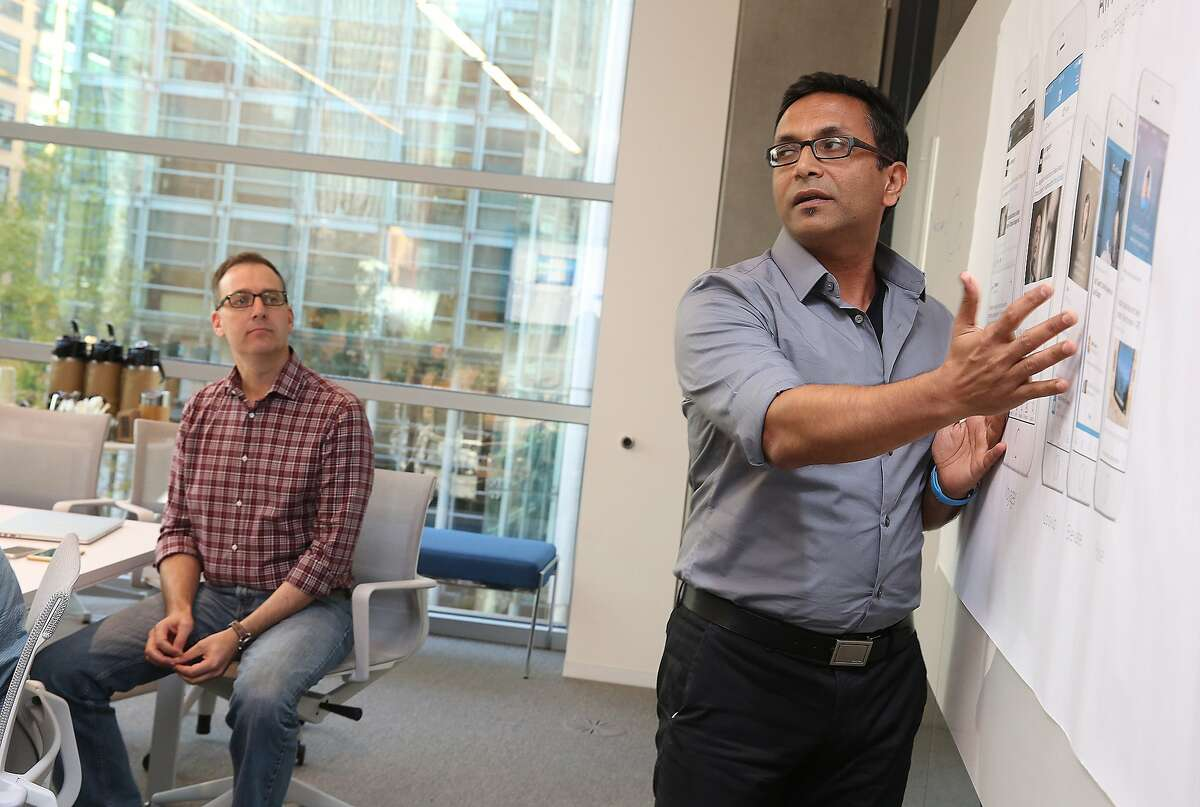 VP of mobile product Joff Redfern (left) listens as director of user design Hemendra Kumar (right) talks about new user design at LinkedIn in their office in San Francisco, Calif., on Wednesday, October 14, 2015.