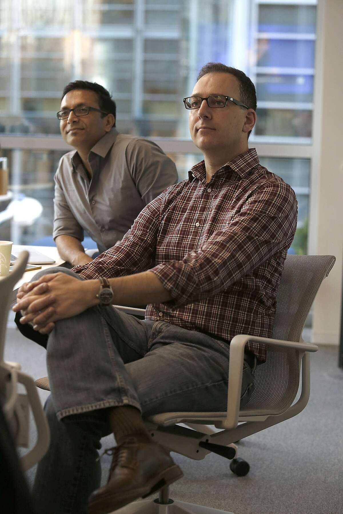 VP of mobile product Joff Redfern (front) and director of user design Hemendra Kumar (back) watch a live feed from Anaheim about new design app at LinkedIn in their office in San Francisco, Calif., on Wednesday, October 14, 2015.