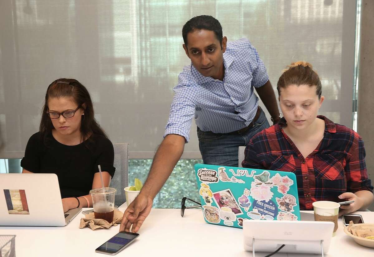VP of engineering Kiran Prasad (middle) shows new user design to CBS Interactive/B2B senior editor Rachel King (left) and The Next Web reporter Lauren Hockenson (right) at LinkedIn in their office in San Francisco, Calif., on Wednesday, October 14, 2015.