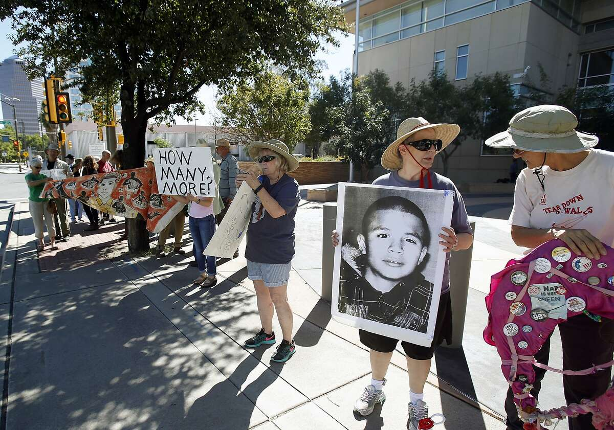 Supporters from a number of humanitarian groups gather at a vigil for border shooting victim José Antonio Elena Rodríguez in front of the federal courthouse in Tucson, Ariz on Friday, Oct. 9, 2015. The vigil proceeded the arraignment of Border Patrol Agent Lonnie Swartz, indicted last month on suspicion of second-degree murder in the October 2012 shooting of Rodríguez.