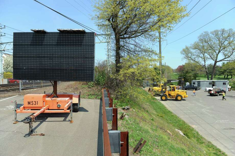 Part of the Old Greenwich Metro-North station parking lot is closed as construction crews set up a staging area for the start of the train bridge construction project in Old Greenwich, Conn. Monday, May 4, 2015. The project, scheduled for completion in 2018, will replace the old bridge crossing Sound Beach Avenue. An update on the construction will be on the agenda for Wednesday night's meeting of the Old Greenwich Association. Photo: Tyler Sizemore / Tyler Sizemore / Greenwich Time