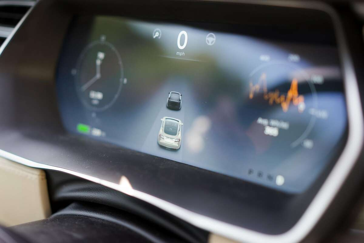 The newly upgraded instrument panel inside a Tesla detects how close it is to other vehicles during a test drive in Palo Alto, Calif. on Wednesday, Oct. 14, 2015. An update to Tesla's Autopilot system will aide drivers in changing lanes, parking and steering.
